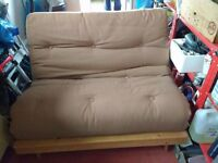 Pine framed double futon with brown cushion