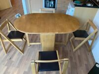 Folding dining table with 4 chairs and built-in storage