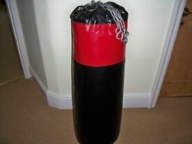 Boxing Punch Bag & 3 pairs of gloves size medium. Virtually as new condition. Hardly used.