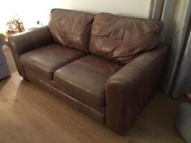 Pair of Heals brown leather sofas