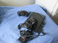 Playstation 2 with 2 joysticks for sale £25.