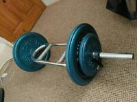 Cast iron weights and curl bar