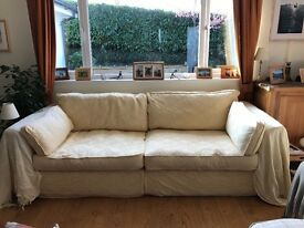 Large pale yellow, very comfortable sofa.