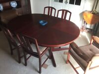 Extendable Dining table and 6 chairs can seat up to 8.