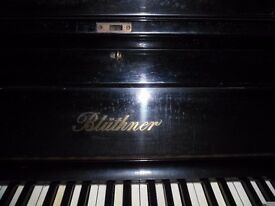 upright piano by bluthner