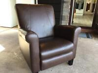 A manual recliner, very comfortable, very solid arm chair