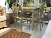 Painted wood kitchen table and two chairs