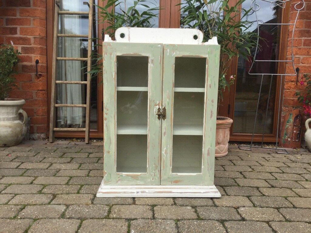 Shabby chic wooden display cabinet.