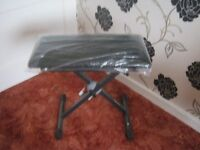MUSIC STOOL FOR KEYBOARD OR PIANO WAS BOUGHT BUT NEVER USED FOR YAMAHA KEY BOARD