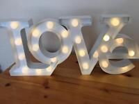 Love letter light up sign. Wedding. Bedroom.