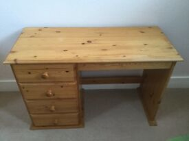 Solid Pine desk with four drawers.