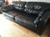Black leather 4 seater and 2 seater sofas