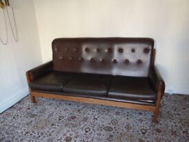 Chocolate Brown Faux leather sofa. Really solid frame. Dundonald.