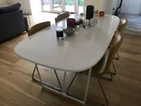 Large white Ikea Table Seats 6 and four Ikea Bernhard leather chairs in yellow. As new.