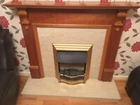 Wooden fireplace, marble hearth and marble back panel with dimplex electric fire