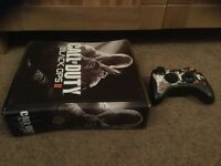 Xbox 360 and controller for sale.