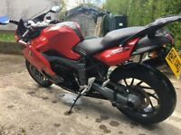 K1300S (2012) in Red with heated grips, ABS, ESC, ESA, and Full Akrapovik Exhaust system