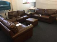 Brand New 100% Tan Leather 3 Seater and two 2 seater Sofas including storage stool.
