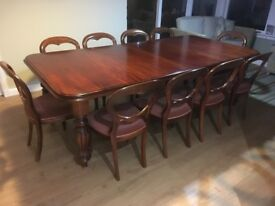 Solid Oak Mahogany table and 10 matching chairs