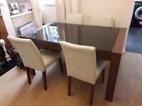 Smoked glass top dining table and 4 chairs