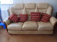 Three piece leather suite with three seater settee, good condition. Complete with cushions.