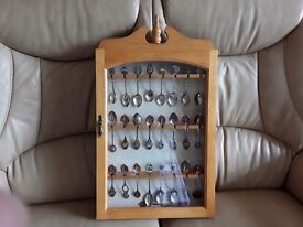 Silver spoon collection with display case
