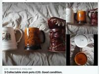 3 Collectable mugs.