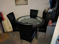 Harveys Glass dining table and chairs