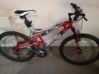 Mens full suspension mountain bike, to fit 27-35 inch leg.