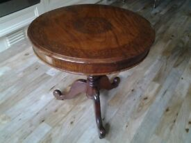 Circular wood table with inlay design