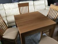 Solid Oak dining table and 4 chairs- excellent condition