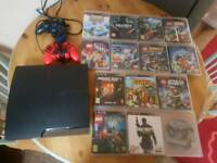 Ps3 with 2 controllers and 14 games