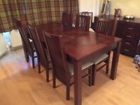 Dining Table and 6 chairs in dark wood and cream leather.