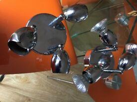 Flush ceiling spotlights. 2 light fittings each with 3 spotlighs