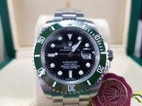 New boxed with papers set silver bracelet black face green bezel Rolex submariner 50th anniversary