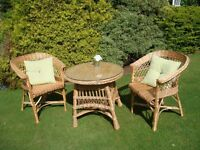 Wicker table and two chairs ideal for conservatory