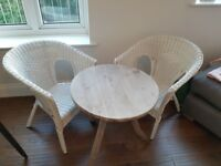 Fenwicks cafe style wooden table and 2 white wicker chairs