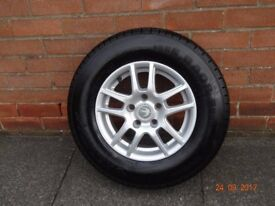 Swift alloy 5 stud 14ins genuine wheel fitted with 185Rx14 tyre