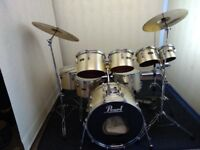 Vintage Pearl 8 pc drum kit with Paiste cymbals.