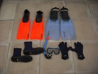 Two pairs of scuba fins plus other scuba gear