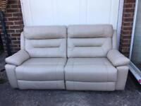 Beautiful soft Italian leather sofa in taupe, manual reclining. Brand new.