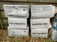 Boxes of mixed white tiles