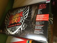 PlayStation 3 guitar hero bundle. 3 games. 1 guitar. 1 drum kit. 1 microphone