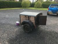 Solid dog trailer for sale. Full electric hook up and spare wheel included.