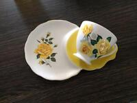 Tea cup and tennis plate saucer