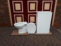 White toilet with back unit.