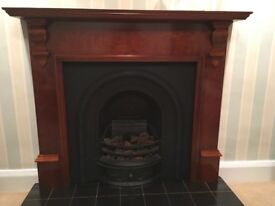 Victorian cast iron insert with polished surround and tiled hearth