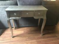 Silver embossed table