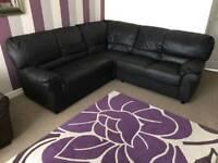 Dark brown/black corner sofa