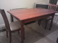 Table and chairs nice wood table and chairs. good conditions. accept offers